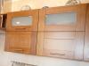 Кухня Тюлье в стиле модерн из массива натурального оттенка со встроенной техникой