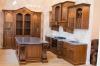 Кухня Миника угловая зеленого цвета в современном стиле со шкафами до потолка
