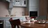 Кухня Нольте из массива дерева с подвесными шкафами и полками