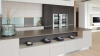 Кухня Есения в современном стильном исполнении серого цвета со встроенным столом